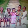 Consolee Consolee Nishimwe, second from right, sits with her sisters and brothers in front of her Rwandan home in 1993, just a few months before the genocide began. The house was destroyed; her brothers were all killed. This is the only photo she still has of them.